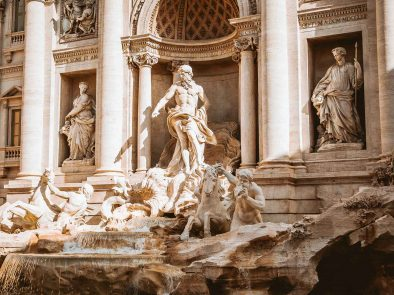 Figures and statues carved in marble at the Trevi fountain.