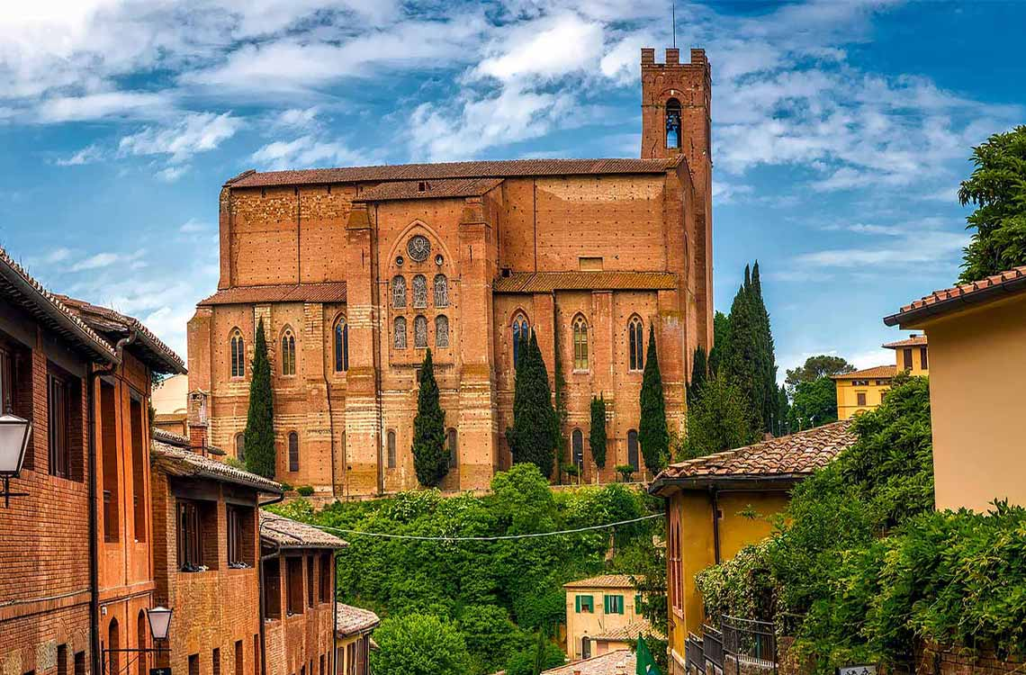 Walking down the cobbled streets and beautiful architecture with your private guide to Sienna.