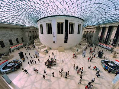 Aerial view of clients enjoying a private tour of the British Museum with their guide.