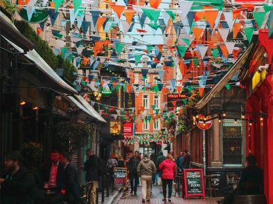 a tour guide and guests enjoying a drink in the temple bar area of dublin.