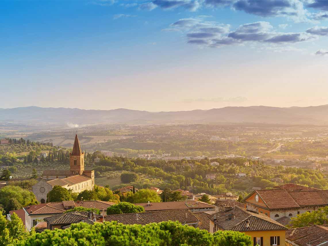 Aerial view of church and sunrise over Perugia in Umbria.